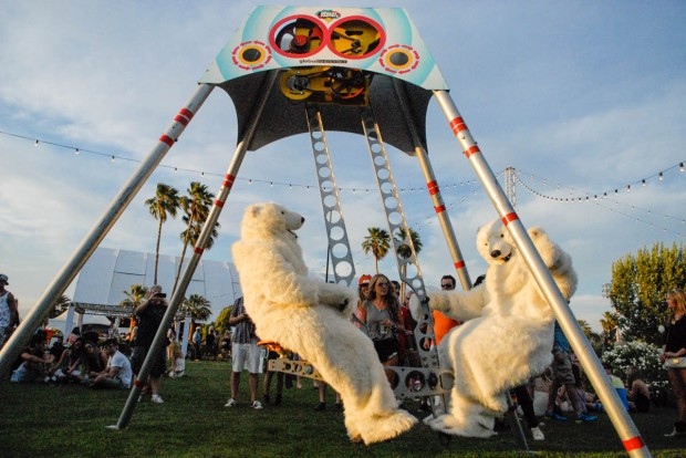 Two polar bears take a break from their jobs to enjoy the summer arts festival and forget, for a few hours, that their ice homes are melting away.   Or maybe, their real work is bringing the message of climate change to the arts festival.